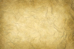 Old yellowish wrinkled paper Stock Photos