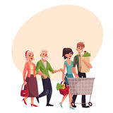 Old and young couples shopping, buying food in grocery store Stock Photos