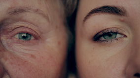 Old and young eye. Granddaughter and grandmother face to face.