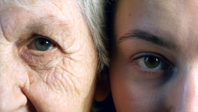 Old and young eye. Grandmother and granddaughter looking together at camera Stock Photography