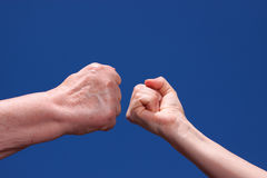 Old and young female fist Stock Photos