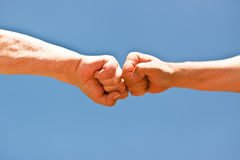 A old and young fist punching each other Royalty Free Stock Photo