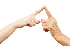 Old and young hand being in touch Stock Photos