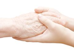 Old and young hands. Isolated on white stock photo