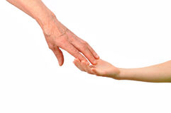 Generation - the hands of grandmother and child. Old and young hands of grandmother and child. Isolated on white background Stock Image