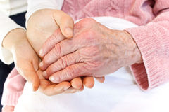 Old and Young Hands on White Blanket Stock Images