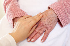 Old and Young Hands on White Blanket Stock Photo