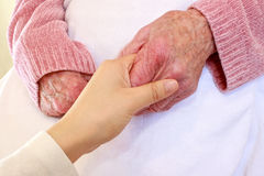Old and Young Hands on White Blanket Royalty Free Stock Photos