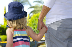 Old and young holding hands Royalty Free Stock Photo