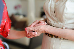 Old and young holding hands Stock Image