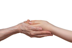 Old and young holding hands of each other. Isolated on a white background Stock Photo