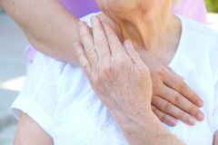 Old and young holding hands on light background close up. Helping hands, care for the elderly concept. royalty free stock photo