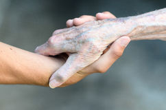 Old and young man shaking hands Royalty Free Stock Image
