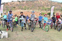 Old and young riders at start of fun Mountain Bike Race Royalty Free Stock Photo