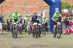 Old and young riders at start of marathon Mountain Bike Race Stock Photo