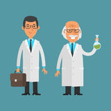 Old and young scientist standing and smiling Stock Photography