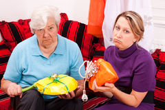 Old and young woman getting loveless gifts Stock Photo