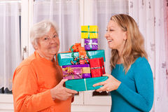 Old and young woman holding gifts Royalty Free Stock Photo