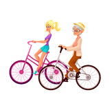 Old and young woman riding bicycle, cycling together. Old and young woman, mother and daughter, grandmother and granddaughter, riding bicycle, cycling together Stock Photo