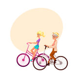 Old and young woman riding bicycle, cycling together. Old and young woman, mother and daughter, grandmother and granddaughter, riding bicycle, cycling together Stock Photos