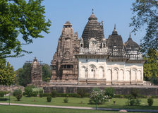 Old and younger Hindu temple at west site in India's Khajuraho. Royalty Free Stock Photo