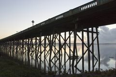 Old Youngs Bay Bridge. Underside of Old Youngs Bay Bridge across Youngs River Bay silhouetted at twilight, Astoria, Oregon, U.S.A stock photo