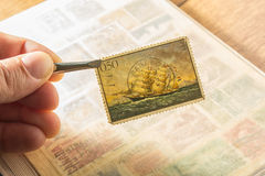 Old Yugoslavian post stamp. Hand holding an old Yugoslavian post stamp Royalty Free Stock Photography