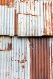 Old Zinc background, Rusted corrugated zinc sheets overlapping t. O form a fence Royalty Free Stock Photography