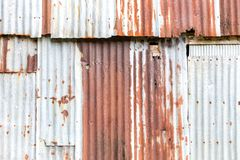 Old Zinc background, Rusted corrugated zinc sheets overlapping t. O form a fence Royalty Free Stock Image