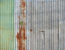 Old zinc metal wall. Old corrugated zinc metal plate wall on the industrial, construction or residential fence, background texture Stock Photography