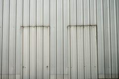 Old zinc wall with twin door Stock Photo