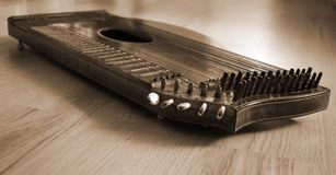Old zither lying on a wooden table. Old zither lying on a wooden table in braun color Stock Photos