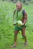 Olde aged Pacific Islander man carry a watermelon on eco tourism. Olde aged Pacific Islander man age 75 carry a watermelon on eco tourism tour in Rarotonga Cook royalty free stock images