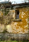 Olde derelict abandoned peasant house stock image