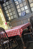 Olde worlde rustic tea room. Photo of a vintage rustic olde worlde tea room with table covered in gingham cover Royalty Free Stock Photo