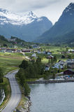 Olden, Norway. A highway leading to Olden village with mountains in background Stock Photography