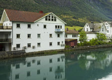 Olden, Norway. Houses near canal in village Olden, Norway Royalty Free Stock Photo