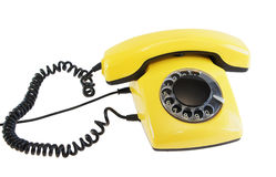 Olden yellow phone Royalty Free Stock Photos