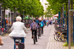 OLDENBURG, GERMANY - JUNE 10, 2017: A group of cyclists riding around the old town. Copy space for text. OLDENBURG, GERMANY - JUNE 10, 2017: A group of cyclists Stock Photo