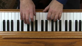 Older Adult Male Hands Playing Piano From Above. Birds-eye View Of Older Male Hands Playing Piano stock video footage