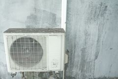 Older air conditioning on the wall.Air conditioner compressor Stock Image