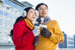 Older asian couple with coffee to go Royalty Free Stock Photo