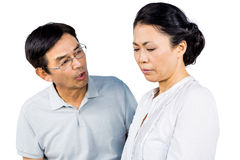 Older asian couple having an argument. On white background Royalty Free Stock Image