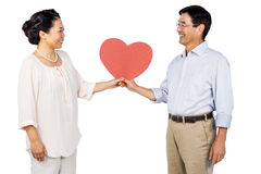 Older asian couple holding heart Stock Photography