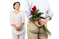 Older asian couple with roses. On white background Stock Images