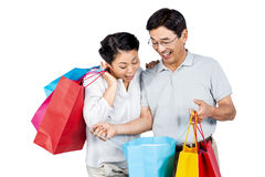 Older asian couple with shopping bags Stock Image