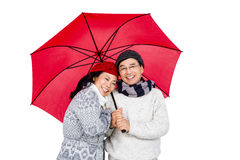 Older asian couple under umbrella Stock Photo