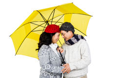 Older asian couple under umbrella Stock Image