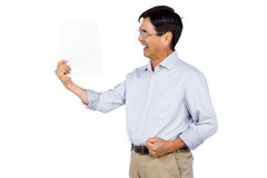Older asian man showing a page Stock Photo