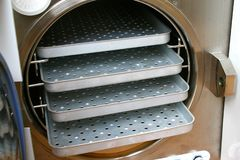 Older autoclave chamber with stainless shelves Stock Image
